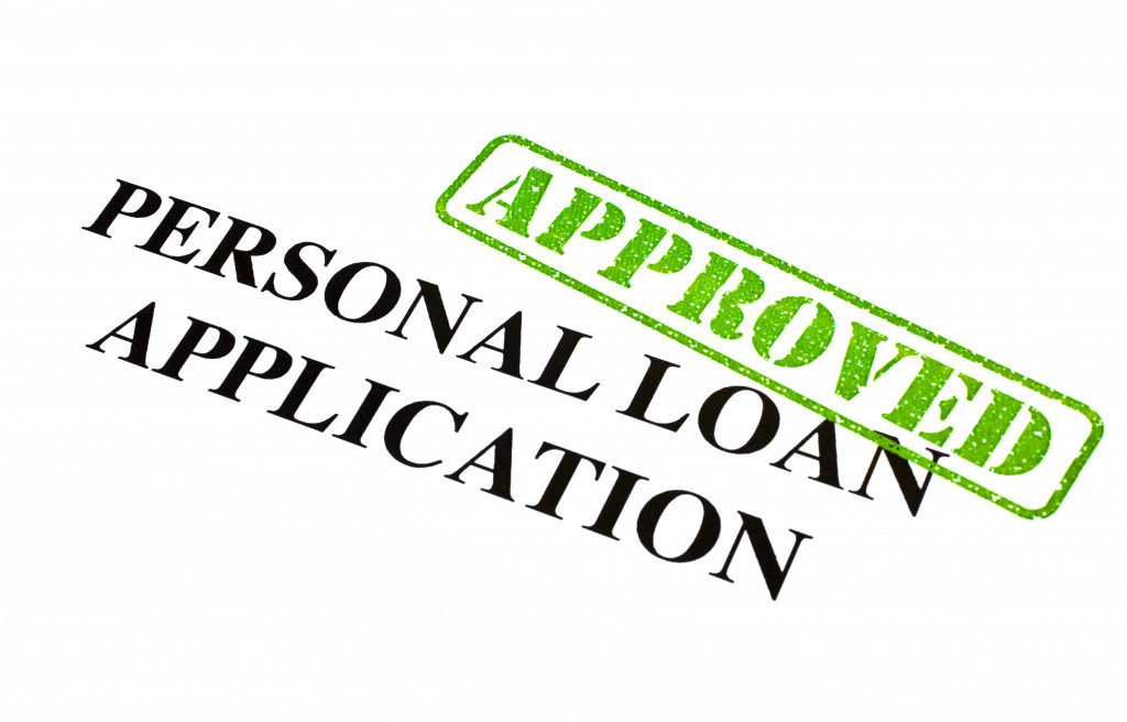 A close-up of an APPROVED Personal Loan Application document.