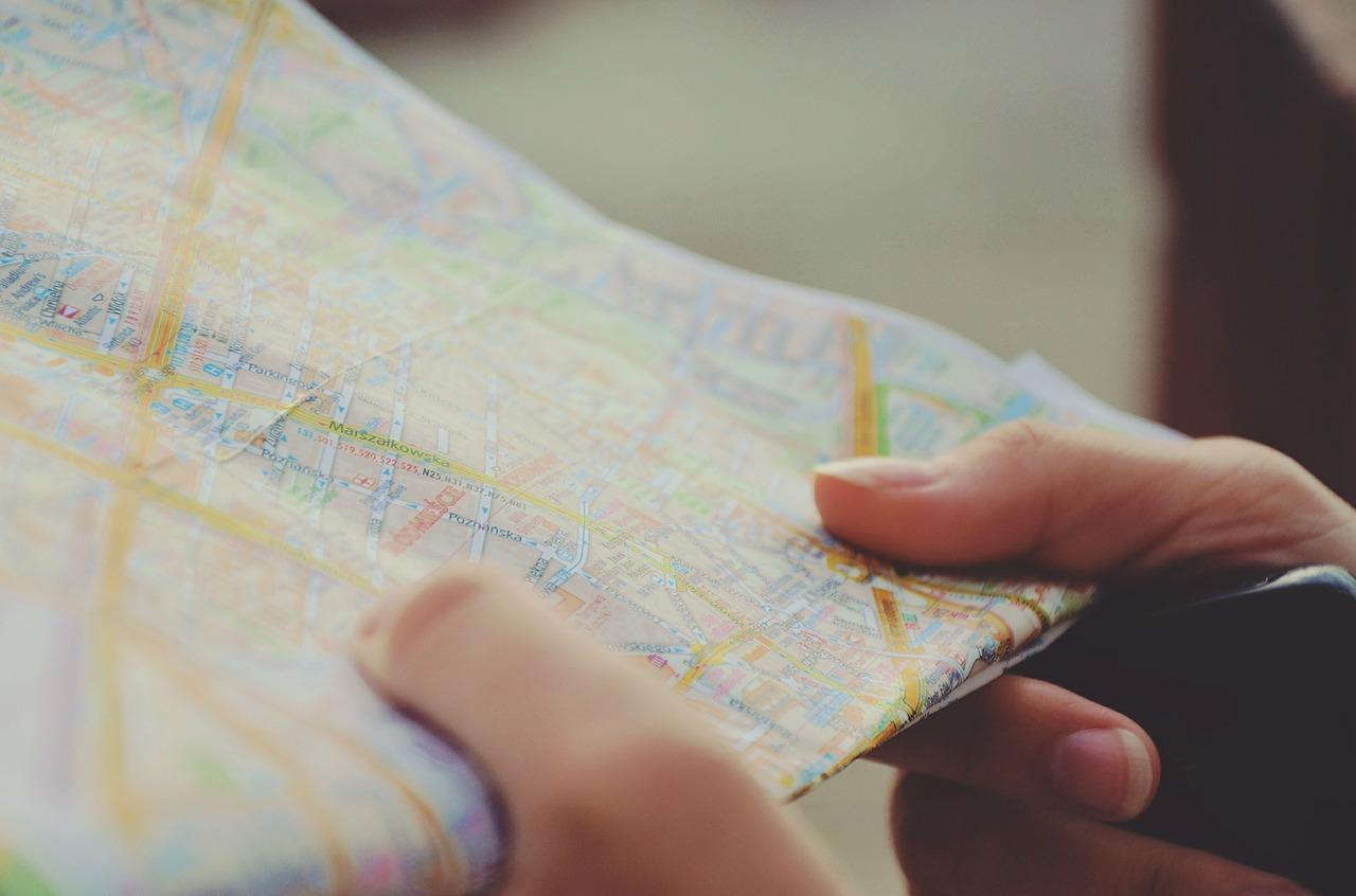 tourist holding a map