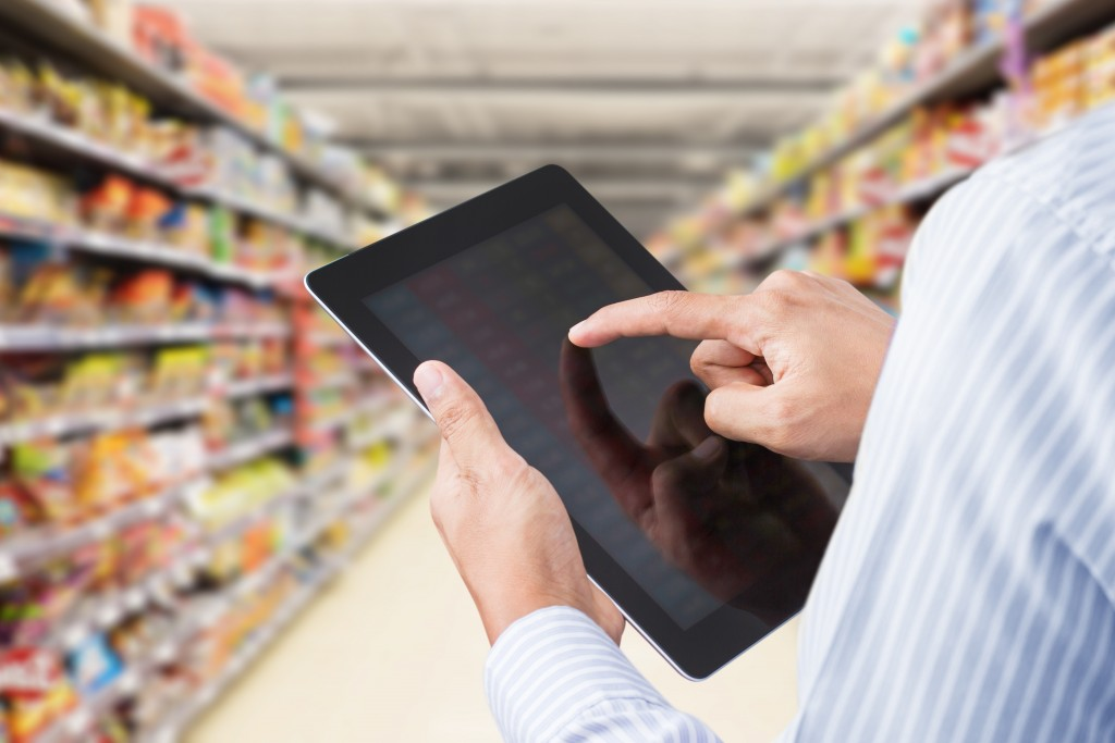 using tablet at the grocery