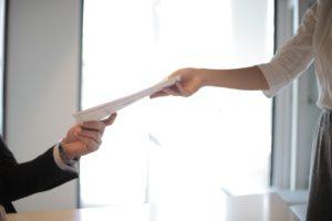 handing paper over