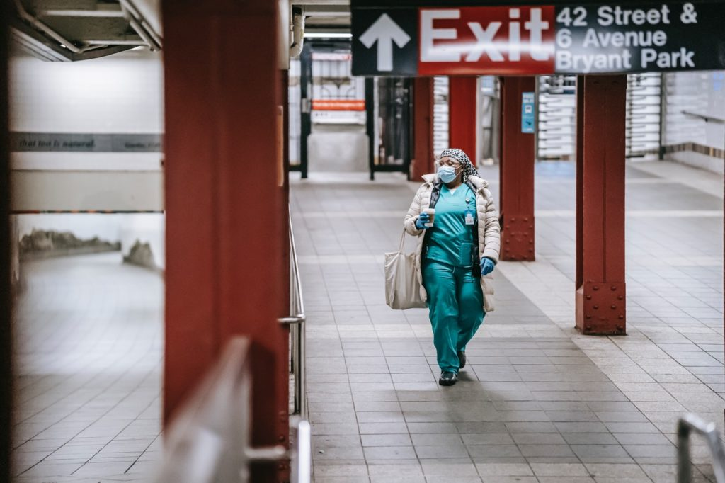nurse walking through the train station