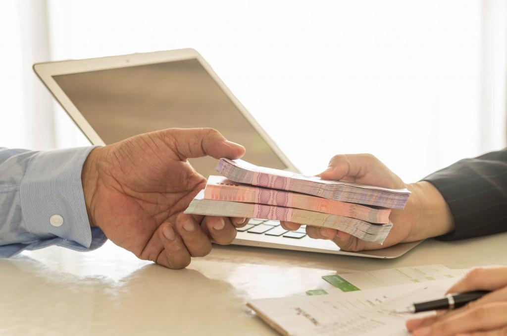 man receiving cash