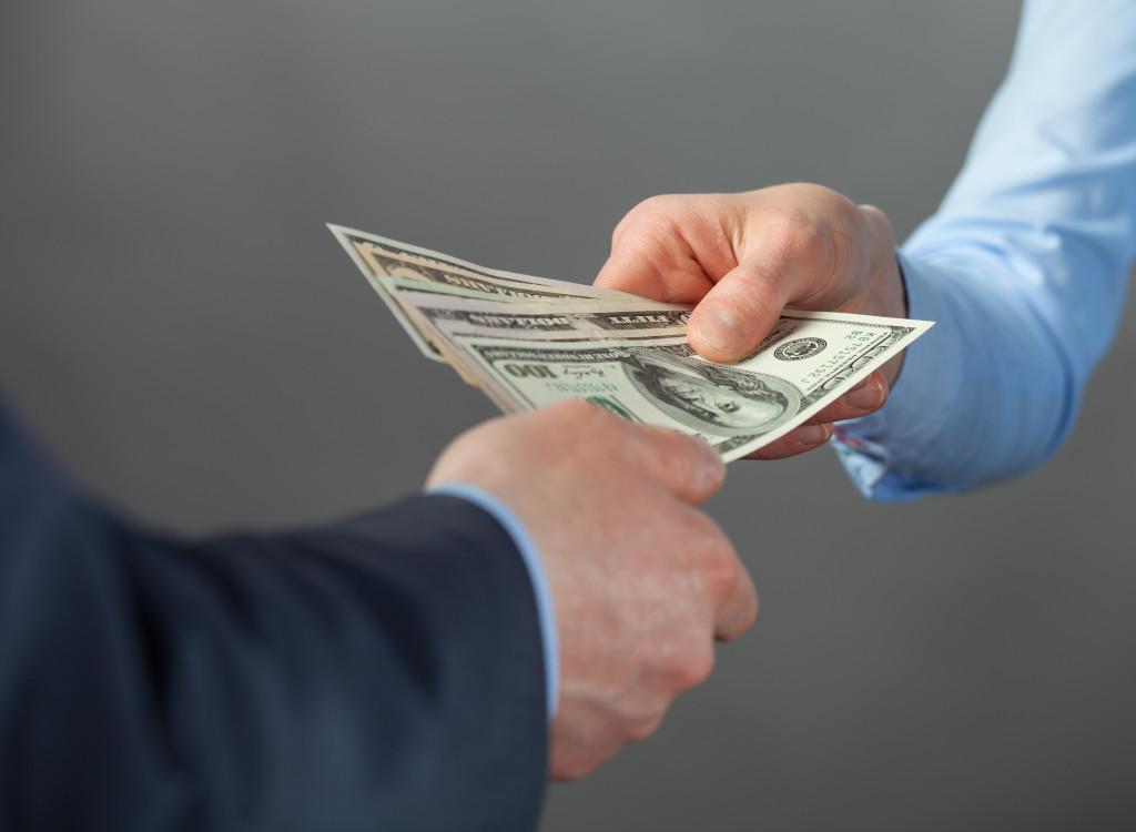 man receiving cash payment