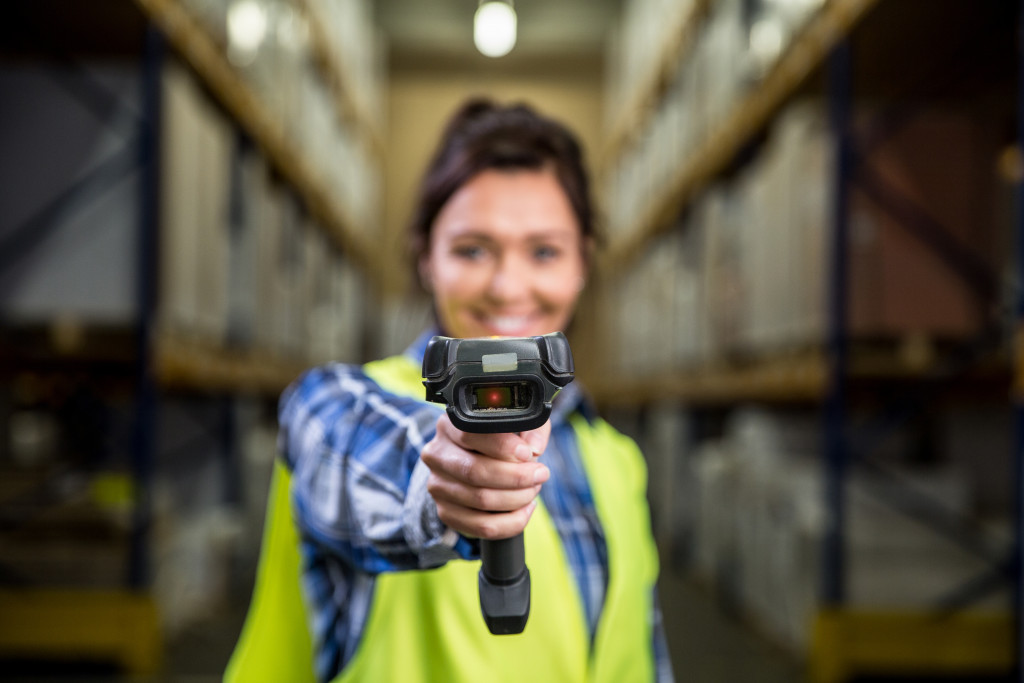 employee holding a barcode scanner