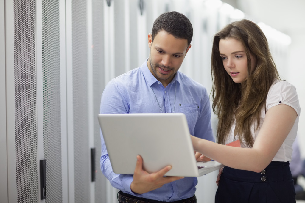 two people checking on their computer