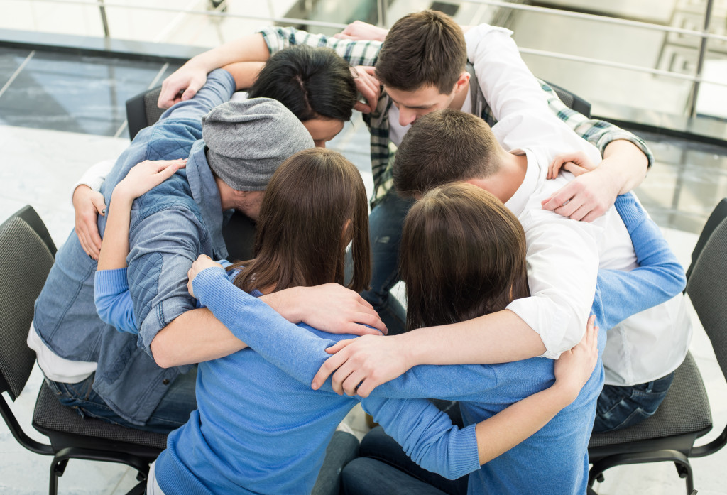 employees hug and team up with each other