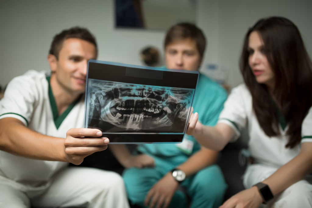 dentists with x-ray image