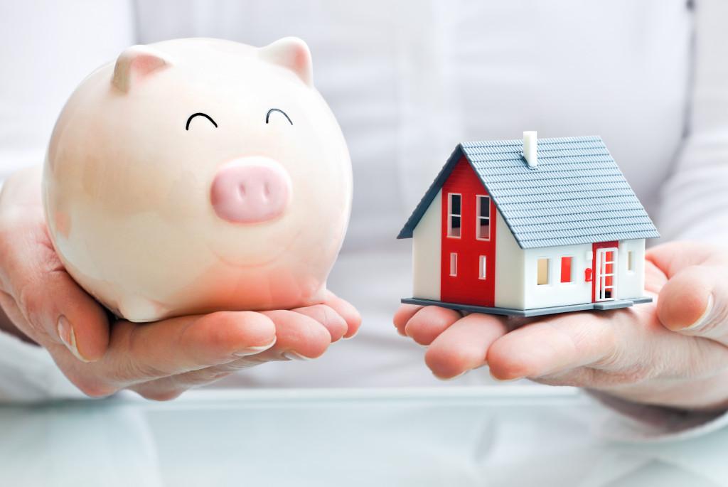 a piggybank and a diorama of a house