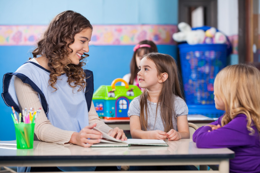 teacher speaking to a student
